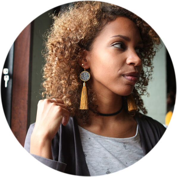 Luxe gold coin black ochre tassel art earrings