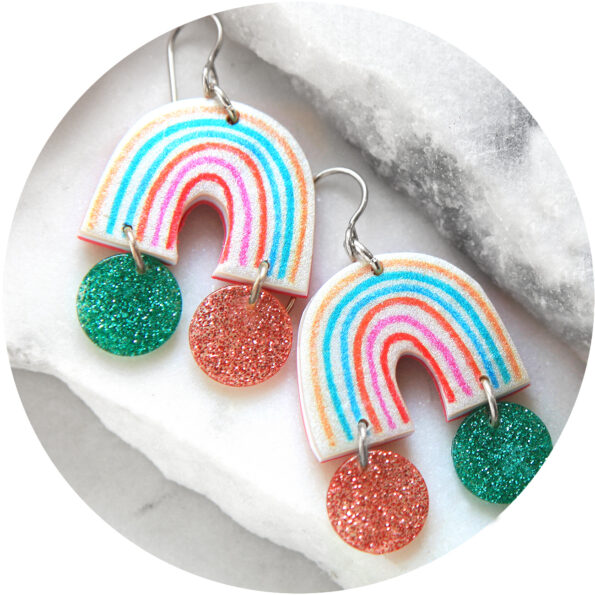 pink teal pastel rainbow art earrings with glitter at the end of the rainbow next romance jewellery designs