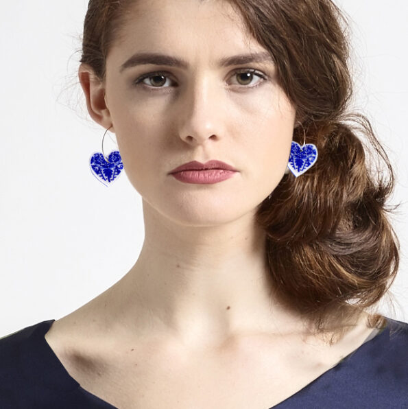 blue ceramic heart hoop on model earrings